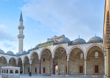 The Suleymaniye Mosque's courtyard. ISTANBUL, TURKEY - JANUARY 21, 2015: The scenic covered gallery in the courtyard of the Suleymaniye Mosque, decorated with Stock Photos