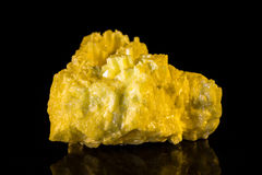 Sulfur in front of black Stock Photo