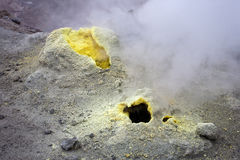 Sulfur fumarole in active volcanic crater Stock Photos