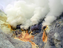 Sulfur fumes. Yellow sulfur fumes at the botom of Ijen volcano in Indonesia royalty free stock images