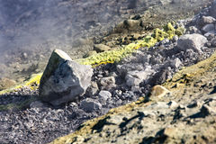 Sulfur haze and crystals on the rocks. Vulcano Island in the archipelago of Aeolian Islands close to Sicily - Italy. Royalty Free Stock Photography