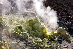 Sulfur haze and crystals on the rocks. Vulcano Island in the archipelago of Aeolian Islands close to Sicily - Italy. Stock Photos