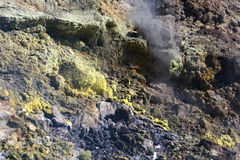 Sulfur haze and crystals on the rocks. Vulcano Island in the archipelago of Aeolian Islands close to Sicily - Italy. Royalty Free Stock Images