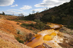 Sulfur and iron polluted river at Sao Domingos abandoned mine Royalty Free Stock Photo