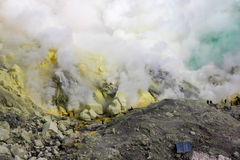 Sulfur mine with workers. In Kawah Ijen, Java, Indonesia Stock Photos
