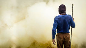 Sulfur Miner at Kawah Ijen Crater, East Java, Indonesia Royalty Free Stock Photography