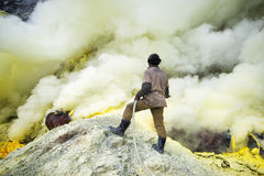 Sulfur Miner at Kawah Ijen Vocano, East Java, Indonesia Royalty Free Stock Images