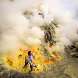 Sulfur Miner at Work Inside Crater of Kawah Ijen, Indonesia Royalty Free Stock Photography