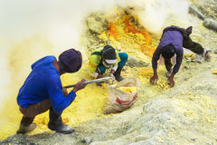 Sulfur Miners at Work, Kawah Ijen Volcano, East Java, Indonesia Royalty Free Stock Photography