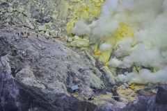 Sulfur mining at mount Ijen Indonesia royalty free stock images