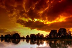 Sulfur sky. Over a pond Stock Photography