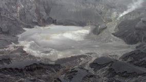 Sulfuric fumaroles in the Tangkuban Parahu volcano crater stock video footage