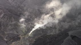 Sulfuric fumaroles in the Tangkuban Parahu volcano crater stock video footage