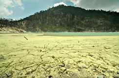 Sulfuric mineral on the floor of Kawah Putih crater or Stock Photos