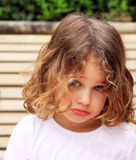 Sulking. A young caucasian child with a pretty face sulking and pouting against a natural background Stock Photo