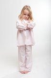 Sulking blonde kid in her pajamas Stock Photos