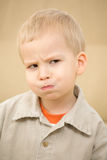Sulking boy. In a corduroy shirt Royalty Free Stock Photography