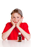 Sulking teenager with medicine bottle Royalty Free Stock Photos