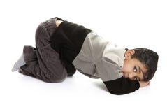 Sulking Toddler Throwing a Tantrum. Sulking Toddler Throwing a Temper Tantrum, Isolated, White royalty free stock photography