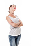 Sulking woman with arms folded posing with chin up for arrogance Royalty Free Stock Photos