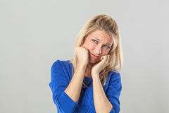 Sulking young blond woman expressing shame and stress Royalty Free Stock Photo