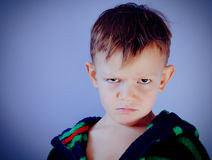 Sulky angry little boy Royalty Free Stock Photography