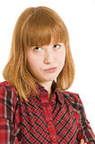 Sulky girl with auburn hair. Portrait of sulky girl with auburn hair, white studio background Royalty Free Stock Images