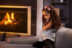 Sulky little girl in living room Stock Images