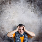 Sulky Man Clasping His Head With Both Hands Royalty Free Stock Image