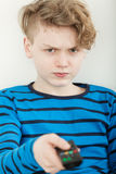 Sulky petulant young boy watching television Stock Images