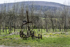 Sulky Plow. A vintage sulky plow rests in a field in Schoharie, New York Stock Images