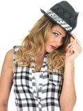 Sulky Sultry Young Fashionable Woman Wearing Black Tilbury Hat Royalty Free Stock Photography