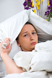 Sulky woman in bed Royalty Free Stock Photos