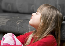 Sulky young girl. Side portrait of sulking young girl Stock Image
