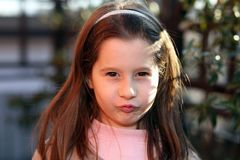 Sulky young girl outdoors in park Royalty Free Stock Images