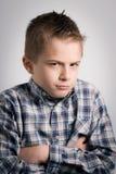 Sullen boy stock photo