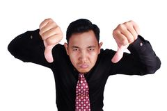 Free Sullen Businessman Shows Thumbs Down Stock Photos - 108132873