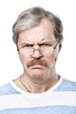 Sullen caucasian mature man in glasses isolated Stock Photo