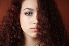 Sullen girl with natural curly hair Royalty Free Stock Images