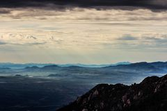 Sullen sky over mountains Stock Images