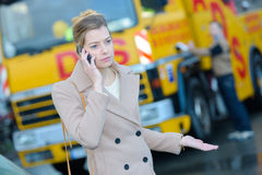Sullen woman on phone Royalty Free Stock Image