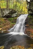Sullivan Falls Autumn. Sullivan Falls plunges down a rocky cliff in the autumn woods of Pennsylvania Royalty Free Stock Images