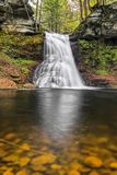Sullivan Falls Reflection. Sullivan Falls, a beautiful Pennsylvania waterfall, splashes down a cliff in an autumn landscape royalty free stock images