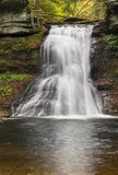 Waterfall on Sullivan Run. Sullivan Falls, a waterfall in northeastern Pennsylvania, plunges over a cliff surrounded by fall color Stock Image