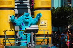 Sully. One of the main characters from Disney's Monsters Inc. is greeting the crowd during the afternoon parade in Disneyworld Orlando Royalty Free Stock Images