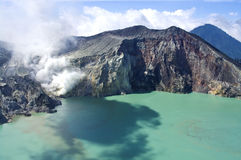 Sulphatic lake in a crater of volcano Ijen. stock photography