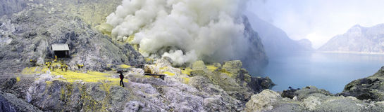 Sulphatic lake in a crater of volcano Ijen Stock Images