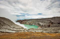 Sulphatic lake in a crater of volcano Kawah Ijen Stock Photos