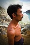 A sulpher miner of Ijen volcano, Ijen, Indonesia Royalty Free Stock Photography