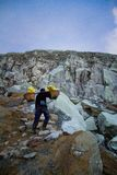 A sulpher miner of Ijen volcano, Ijen, Indonesia Royalty Free Stock Photos